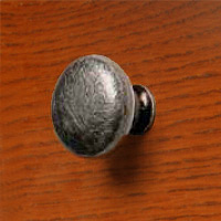 ART55430 Ceramic Knob in Antique Cream finish with a Burnished Iron mount.